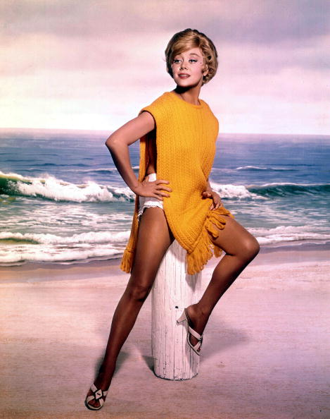 Circa 1950's Actress Glynis Johns wearing a knitted yelow top on the beach.